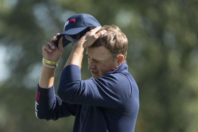 USA team member Jordan Spieth wipes his face on the 18th green on day 2 of the 2016 Ryder Cup at Hazeltine National Golf Club in Chaska, Minnesota on October 1, 2016. Photo by Kevin Dietsch/UPI