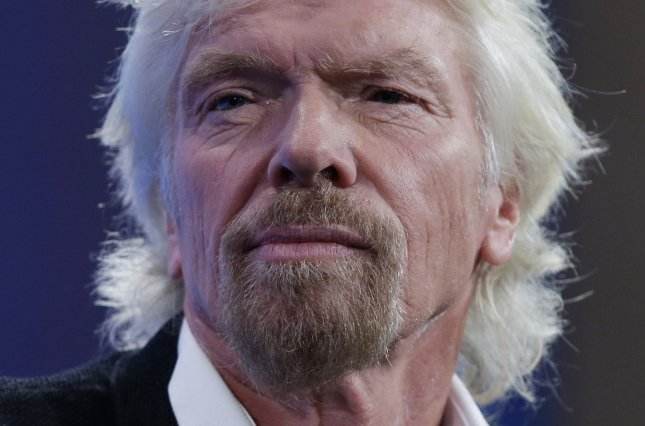 Richard Branson said Monday his Virgin Galactic will begin space test flights in a matter of weeks. File