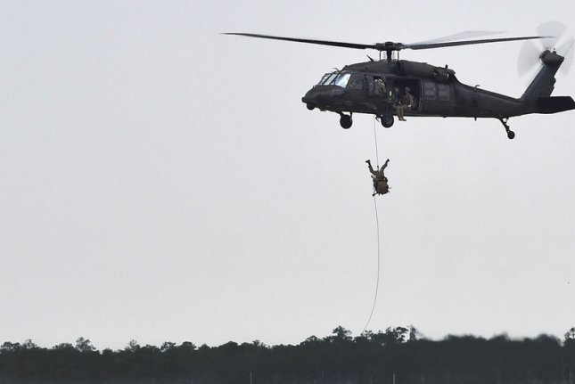 Soldiers fast-rope from a UH-60 Black Hawk during exercises at Hurlburt Field, Fla. File Photo by Senior Airman Logan Carlson/U.S. Air Force/UPI