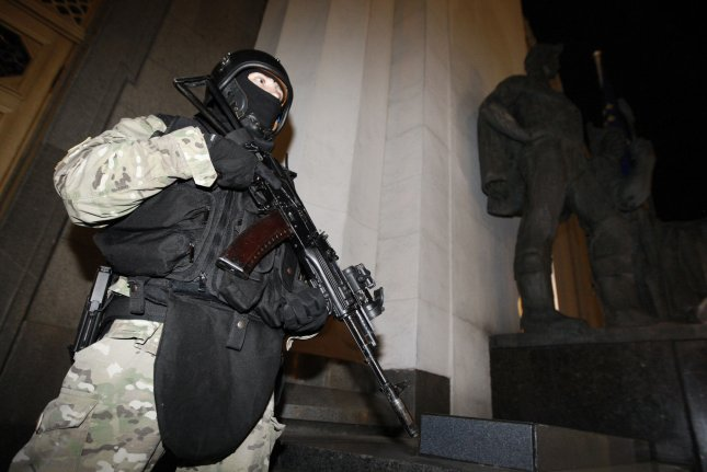 Ukrainian special forces guard the parliament building in Kiev on May 1, 2014, prepared for a possible Russian military incursion following Moscow's annexation of Crimea. File Photo by Ivan Vakolenko/UPI
