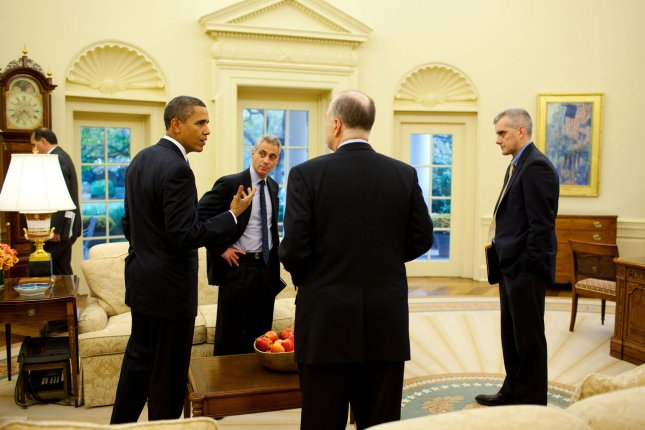 President Barack Obama talks with Chief of Staff Rahm Emanuel, Deputy National Security Advisor Tom Donilon and NSC Chief of Staff Denis McDonough in the Oval Office, October 28, 2009. UPI/Pete Souza/White House
