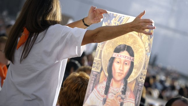 A woman holds a painting representing Kateri Tekakwitha in St Peter's square in the Vatican City on October 21, 2012. Pope Benedict XVI named seven new saints today, Kateri Tekakwitha of the US, Jacques Berthieu of France, Maria Anna Cope of Germany, Pedro Calungsod from the Philippines, Maria Schaffer of Germany, Giovanni Battista Piamarta of Italy, Maria del Carmen of Spain, in St. Peter square at the Vatican. UPI/Stefano Spaziani
