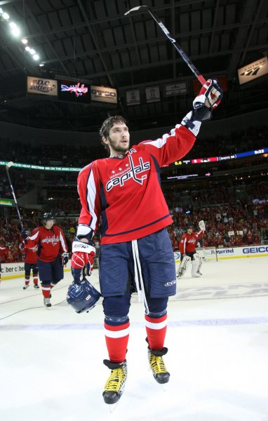 Washington Capitals Alex Ovechkin (8) waves to the crowd after the Pittsburgh Penguins defeated the Washington Capitals 6-2 in Game 7 of their NHL playoff series at the Verizon Center in Washington, DC on May 13, 2009. (UPI Photo/Bruce Bennett/Pool)