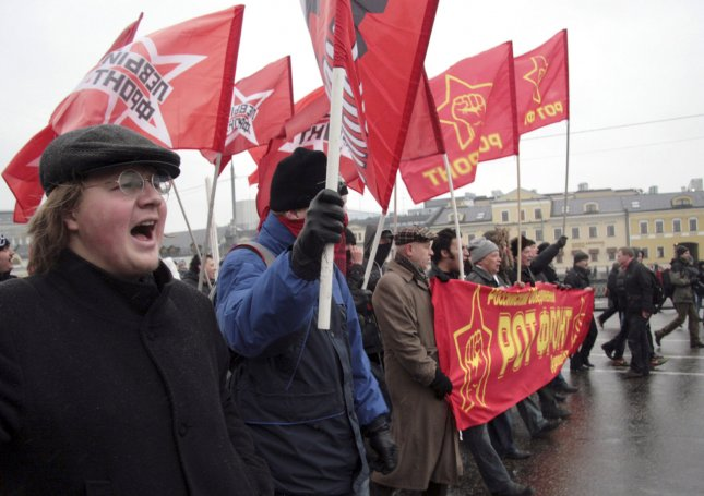 Protesters march during a rally against official results of the parliamentary elections in Moscow on December 10, 2011. UPI .