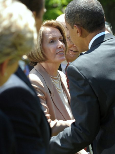U.S. President Barack Obama shakes hands with Speaker of the House Nancy Pelosi, D-CA,after Obama announced tightening of auto emissions and efficiency standards in the Rose Garden of the White House in Washington on May 19, 2009. (UPI Photo/Roger L. Wollenberg)