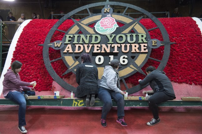 Volunteers add details to floats as preparations are made for the 127th Rose Parade in Pasadena, California on December 30, 2015. The parade will be televised January 1. Photo by Phil McCarten/UPI