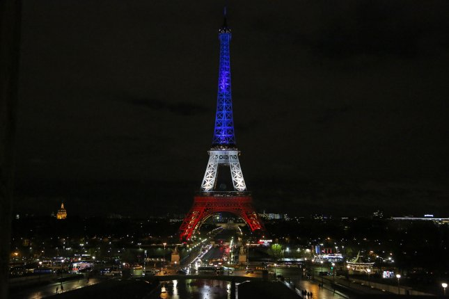 The Eiffel Tower is illuminated in the colors of the French flag as a tribute to those killed in the recent terrorist attacks in Paris on November 19, 2015. Paris Mayor Anne Hidalgo prolonged the special tribute through November 25 after initially ordering the illumination for only three days. Photo by David Silpa/UPI