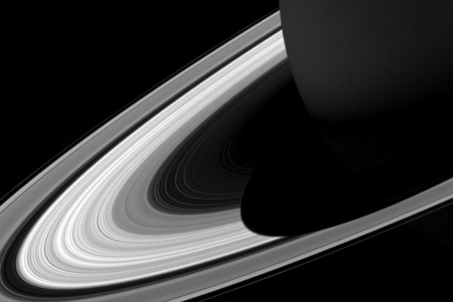The projection of Saturn's shadow on the rings grows shorter as Saturn's season advances toward northern summer, thanks to the planet's permanent tilt as it orbits the sun. NASA/UPI