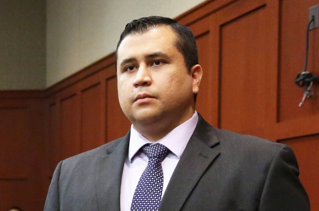 George Zimmerman listens as the verdict is announced that a jury found him not guilty on Day 25 of his trial in the Seminole circuit court in Sanford, Fla., on July 13, 2013. The jury deliberated for 16 hours aver two days. File Photo by Joe Burbank/UPI