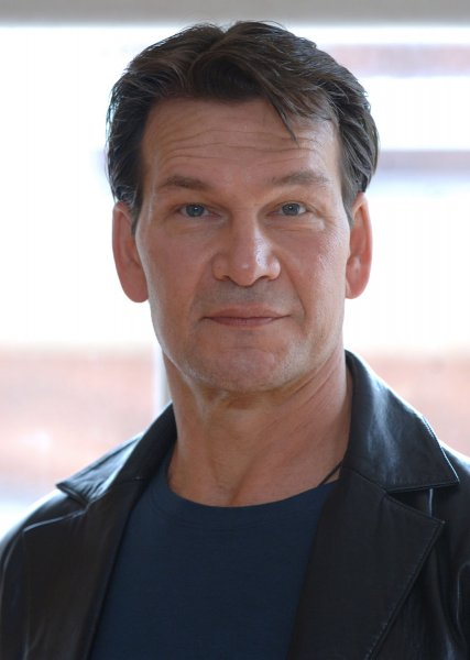 American actor Patrick Swayze attends a photocall for the musical Guys and Dolls at The Century,Piccadilly in London on June 5,2006. (UPI Photo/Rune Hellestad)