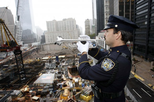Port Authority Police Officer Kim Bonsanti plays Taps as mourners of the victims of September 11th, 2001 terrorist attacks pay their respects during the 8th Anniversary Commemoration Ceremony in New York at Ground Zero on September 11, 2009. UPI/G.N. Miller/Pool