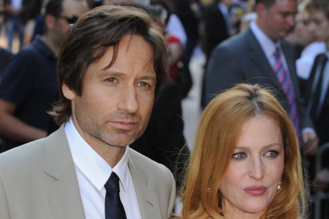 American actress Gillian Anderson and actor David Duchovny attend the premiere of The X-Files: I Want To Believe at Empire, Leicester Square in London on July 30, 2008. 'X-Files' is set to return to television in 2016. File Photo by UPI Photo/Rune Hellestad.
