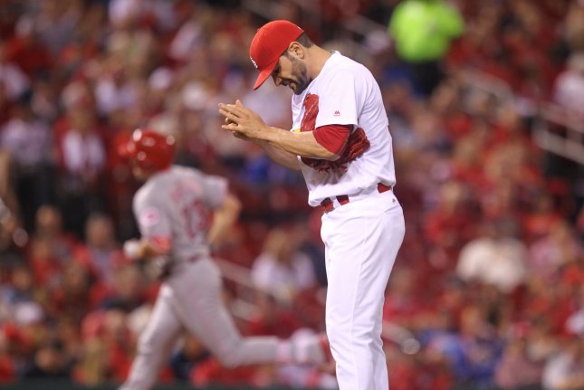 St. Louis Cardinals starting pitcher Jaime Garcia rubs up the baseball after giving up a solo home run to Cincinnati Reds Adam Duvall in the first inning at Busch Stadium in St. Louis on September 26, 2016. Photo by Bill Greenblatt/UPI