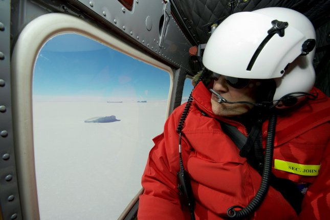 U.S. Secretary of State John Kerry looks out at an iceberg in McMurdo Sound, Antarctica. With his tenure ending, Kerry warned students and leaders at MIT of the dangers of climate change. Photo by U.S. Department of State/UPI
