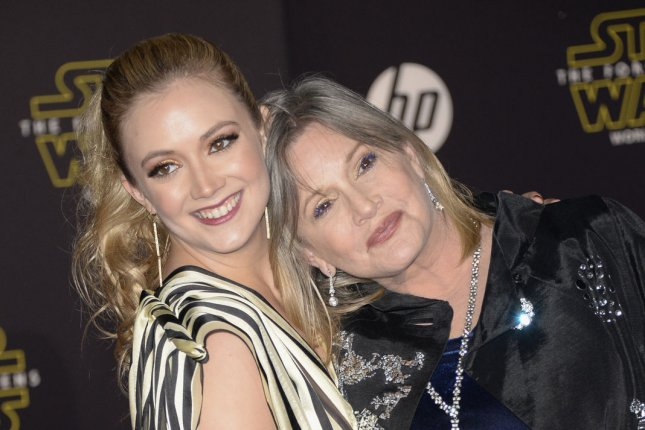 Billie Lourd (L) and mom Carrie Fisher at the Los Angeles premiere of Star Wars: The Force Awakens on December 14, 2015. File Photo by Phil McCarten/UPI