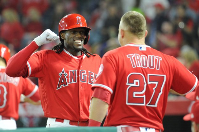 Los Angeles Angels' Cameron Maybin is congratulated by Mike Trout and other teammates after scoring. File photo by Lori Shepler/UPI