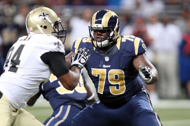 Former Rams offensive lineman Greg Robinson (79) holds off New Orleans Saints defensive end Cameron Jordan in the first quarter on August 8, 2014 at the Edward Jones Dome in St. Louis. File photo by Bill Greenblatt/UPI