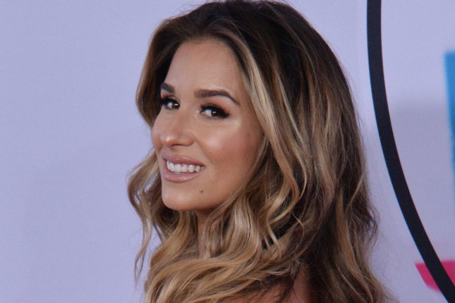 Jessie James Decker drew criticism after appearing to drink wine while nursing. File Photo by Jim Ruymen/UPI