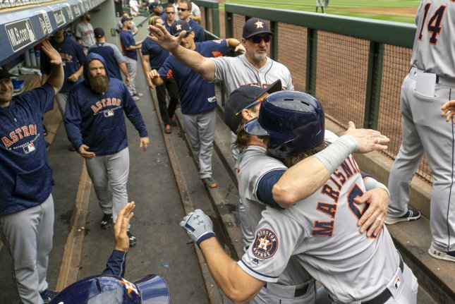 Huston Astros outfielder Jake Marisnick (6) is greeted in the dugout. Photo by Jim Bryant/UPI