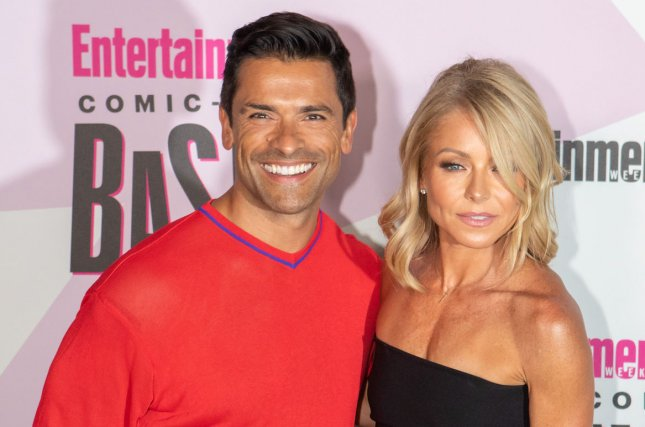 Kelly Ripa (R), pictured with Mark Consuelos, jokingly used a photo of the actor and his Riverdale co-stars on her family's Christmas card. File Photo by Howard Shen/UPI