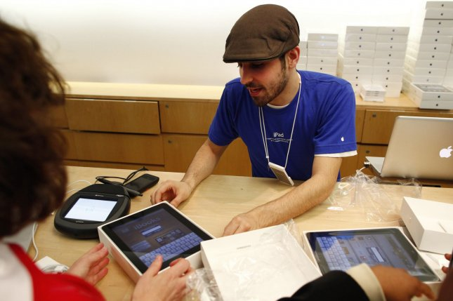 Apple employee Matthew Rivera sets up iPads for new owners at the Apple store in Chicago on April 3, 2010. File Photo by Brian Kersey/UPI