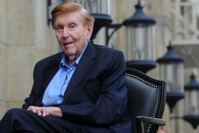 Sumner Redstone, executive chairman of Viacom and CBS Corporation, holds a plaque after he was honored with the 2,467th star on the Hollywood Walk of Fame, during an unveiling ceremony in Los Angeles, Calif., on March 30, 2012. He died Tuesday at the age of 97. File Photo by Jim Ruymen/UPI