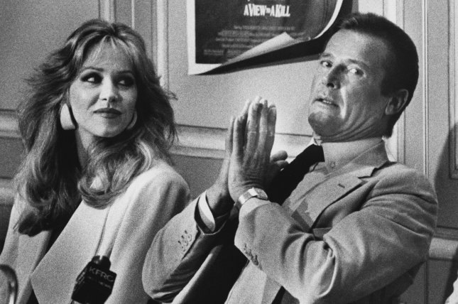 Tanya Roberts (L), pictured with Roger Moore, died Monday after being mistakenly reported dead. File Photo by Lloyd Francis/UPI