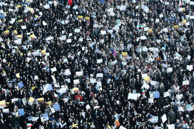 Iranians participate in a pro-government demonstration after Friday prayers in Tehran, Iran on February 18,2011. The demonstrators ask to execute the two opposition leaders, Mir Hossein Mousavi and Mahdi Karroubi. UPI.