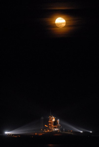 The moon rises before NASA's Space Shuttle Endeavour lifts off from pad 39 A en route to the International Space Station at the Kennedy Space Center in Florida on November 14, 2008. The crew will conduct various maintenance tasks to improve operational performance of the station. In addition, other components will be added to enhance the facility for future crews. (UPI Photo/Roger L. Wollenberg)