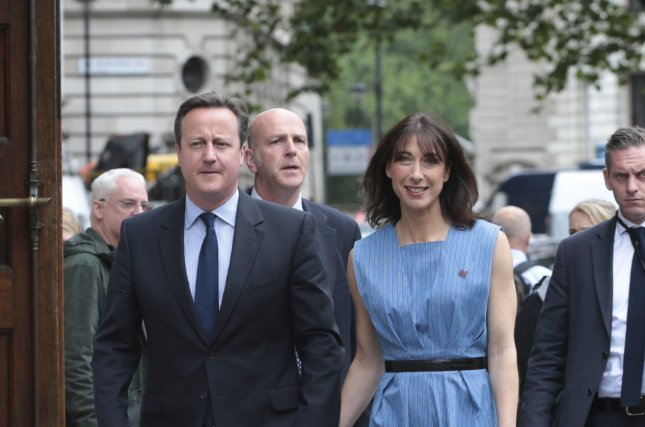 British Prime Minister David Cameron and his wife Samantha arrive at Westminster Polling Office to cast their vote in the referendum on whether the UK will remain a member of the European Union in London on Thursday. Cameron announced Friday morning he would resign after Britian chose to leave the EU. Photo by Hugo Philpott/UPI