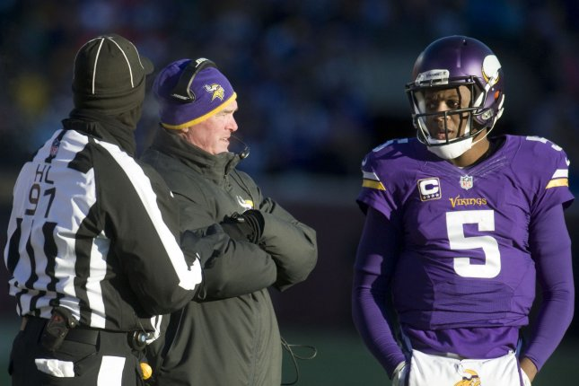 Minnesota Vikings head coach Mike Zimmer talks with quarterback Teddy Bridgewater (5) before attempting a punt against the Seattle Seahawks in the fourth quarter of their AFC Wild Card game at U.S. Bank Stadium in Minneapolis on January 10, 2016. The Seahawks defeated the Vikings 10-9. Photo by Marilyn Indahl/UPI