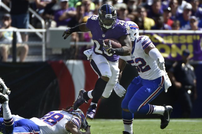 Baltimore Ravens running back Terrance West (C) leaps over Buffalo Bills defenders Ronald Darby (L) and Preston Brown during the first half of an NFL football game at M&T Bank Stadium in Baltimore, Maryland, September 11, 2016. Photo by David Tulis/UPI