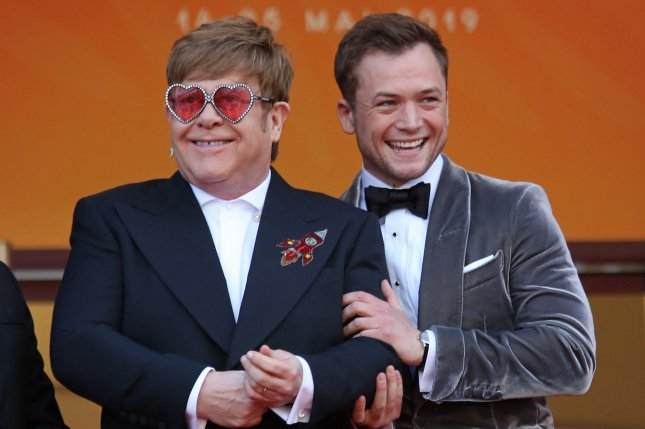 Elton John (L) said he knew Taron Egerton (R) was the right choice to play him in the film Rocketman when he heard the actor sing Don't Let the Sun Go Down on Me, which he described as a particularly difficult song to perform. Photo by David Silpa/UPI