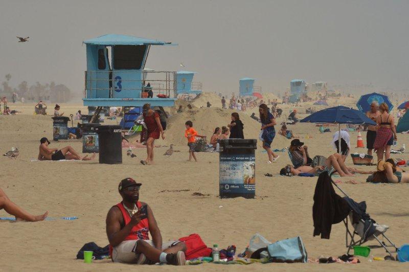 Sunbathers converged onHuntington Beach, California, on April 30, 2020. File photo by Jim Ruymen/UPI