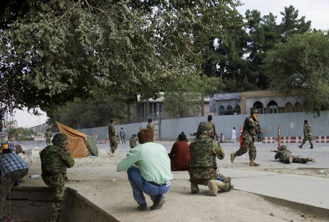 Afghan soldiers takes positions near a building which is occupied by Taliban militants, unseen, in Kabul, Afghanistan on Tuesday, September 13, 2011. Taliban insurgents coordinated attacks on the U.S. Embassy, NATO headquarters and other buildings in downtown Kabul, killing seven Afghans. UPI/Enayat Asadi