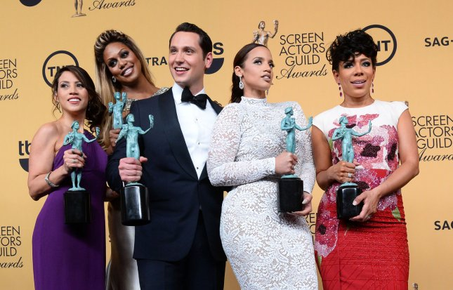 (L-R) Actors Elizabeth Rodriguez, Laverne Cox, Matt McGorry, Dascha Polanco and Selenis Leyva pose backstage with the award for outstanding ensemble in a comedy series for Orange is the New Black at the 21st annual SAG Awards held at the Shrine Auditorium in Los Angeles on Jan. 25, 2015. Photo by Jim Ruymen/UPI