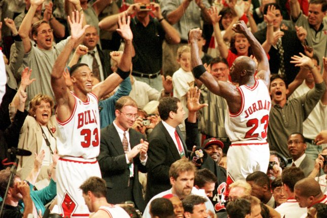 Scottie Pippen and Michael Jordan celebrate along with fans in the United Center after the Bulls became NBA Champs for the fifth time beathing the Utah Jazz 90-86 on June 14, 1997. UPI raf/ Ray Foli
