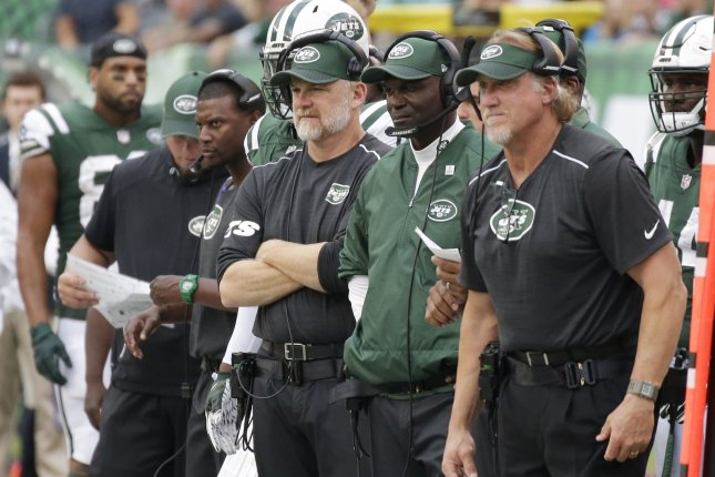 New York Jets head coach Todd Bowles and his coaching staff stand on the sidelines after Austin Seferian-Jenkins fumbles the football as he dives for the end zone in a play that was ruled, after a replay by officials, a touch back giving the Patriots the ball in a controversial decision in week 6 of the NFL at MetLife Stadium in East Rutherford, New Jersey on October 15, 2017. File photo by John Angelillo/UPI