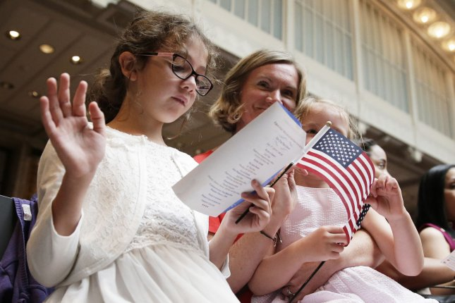 New U.S. citizens take the oath of allegiance administered by U.S. Citizenship and Immigration Services during a naturalization ceremony at the New York Public Library in July. File Photo by John Angelillo/UPI