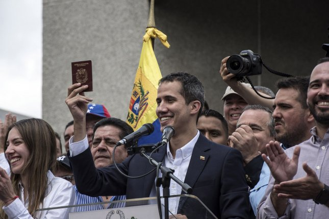 Venezuelan opposition leader and self-proclaimed acting President Juan Guaido attends a rally upon his arrival in Caracas on Monday. Photo by Marcelo Perez/UPI