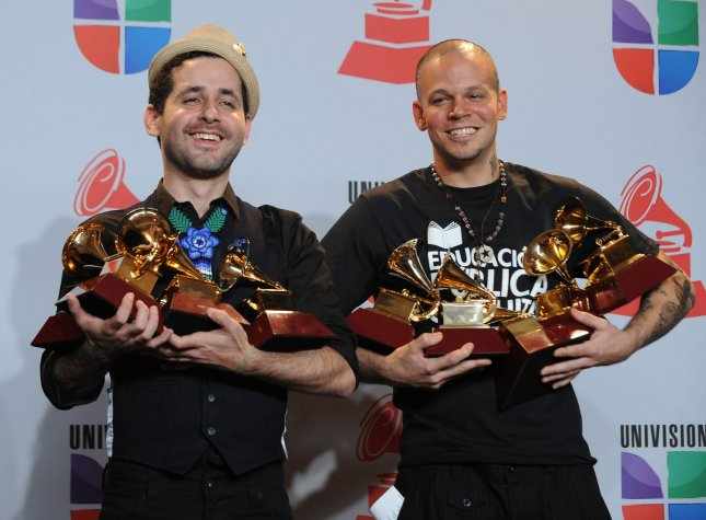 Calle 13, Eduardo JosŽ Cabra Mart'nez (L) and RenŽ PŽrez Joglar appear backstage with some of the 19 awards including Record of the Year and Album of the Year they won at the 12th annual Latin Grammy Awards at the Mandalay Bay in Las Vegas, Nevada on November 10, 2011. UPI/Jim Ruymen