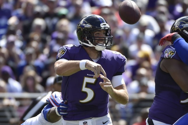 Baltimore Ravens quarterback Joe Flacco (5) throws under pressure from Buffalo Bills defenders during the first half of an NFL football game at M&T Bank Stadium in Baltimore, Maryland, September 11, 2016. Photo by David Tulis/UPI