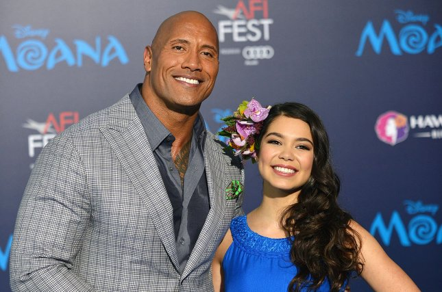 Dwayne Johnson and Auli'i Cravalho arrive at the world premiere of Walt Disney Animation Studios' Moana in Los Angeles on November 14. File Photo by Christine Chew/UPI