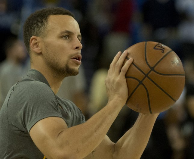 Stephen Curry scored a team-high 30 points while Draymond Green made a key strip of Anthony Davis in the final three seconds to lift the Golden State Warriors to a 113-109 victory over the New Orleans Pelicans on Tuesday night at the Smoothie King Center. File Photo by Terry Schmitt/UPI