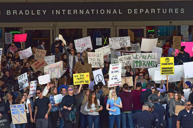 Protesters rally at Los Angeles International Airport on Sunday to speak out against President Donald Trump's new executive order to temporary ban U.S. travel for people from seven countries. Former President Barack Obama said Monday he supports the protests. Photo by Christine Chew/UPI