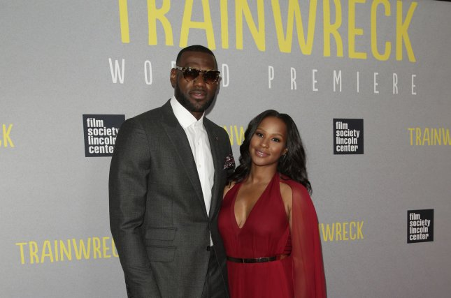 1a2f836c8b2 LeBron James and his wife Savannah arrive on the red carpet at the New York  Premiere of  Trainwreck  at Alice Tully Hall in New York City on July 14