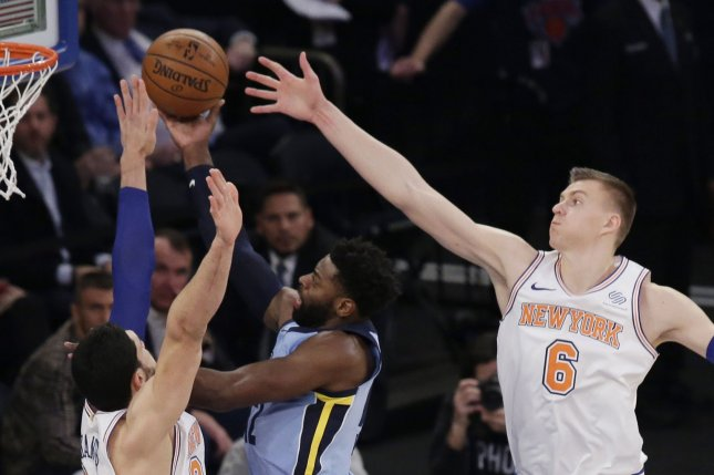 New York Knicks' Kristaps Porzingis plays defense on a shot from Memphis Grizzlies' Tyreke Evans in the first quarter Wednesday at Madison Square Garden in New York City. Photo by John Angelillo/UPI
