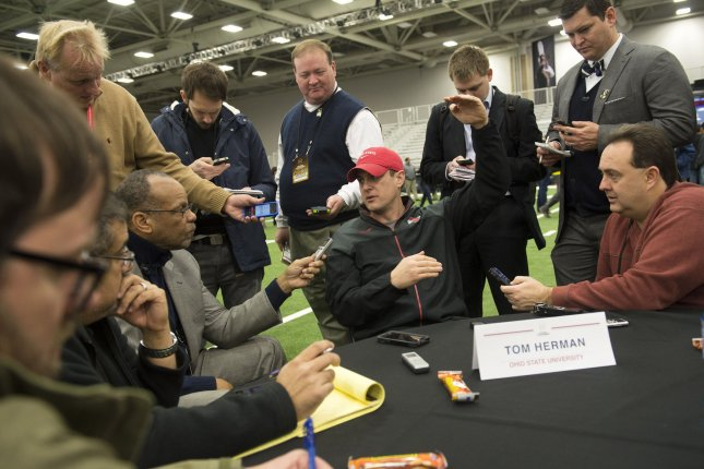 Former Ohio State Buckeyes offensive coordinator Tom Herman (C) answers questions during media day for the 2015 NCAA National Championship Game on January 10, 2015 in Dallas, Texas. File photo by Kevin Dietsch/UPI
