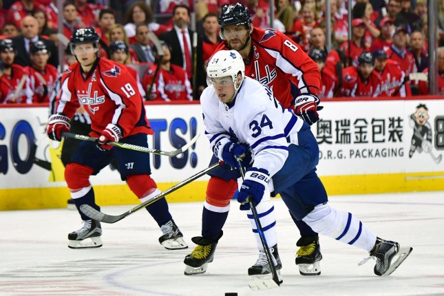 Toronto Maple Leafs center Auston Matthews (34) skates against Washington Capitals left wing Alex Ovechkin (8). File photo by Kevin Dietsch/UPI