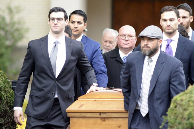The casket of Rose Mallinger exits the Rodef Shalom Temple in Pittsburgh on Friday. Mallinger was the oldest victim of the Tree of Life Synagogue shooting and the final funeral service of the 11 killed. Photo by Archie Carpenter/UPI